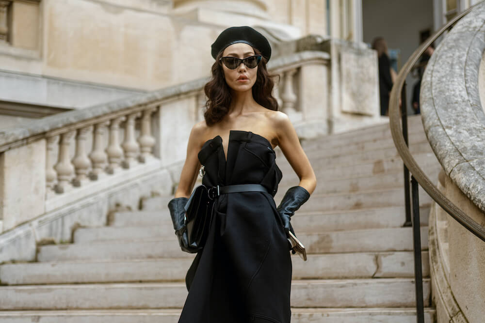 Woman in beret and black Maison Margiela dress seen outside MAISON MARGIELA show, during Paris Fashion Week Womenswear Spring/Summer 2020.