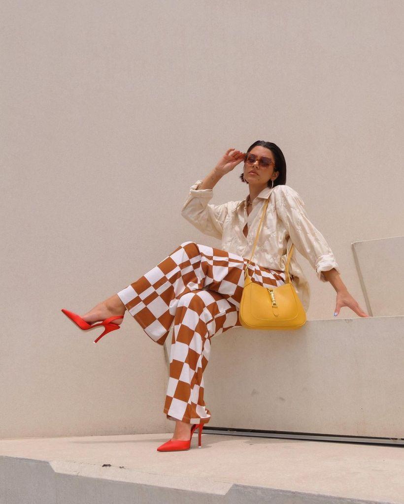 __mmaxinewylde in checkerboard wide legged trousers