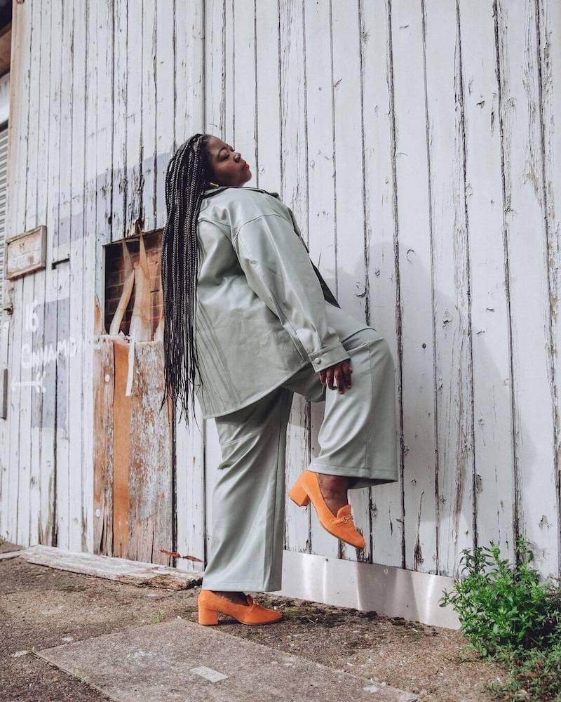 Stephanie Yeboah in wide-legged trousers