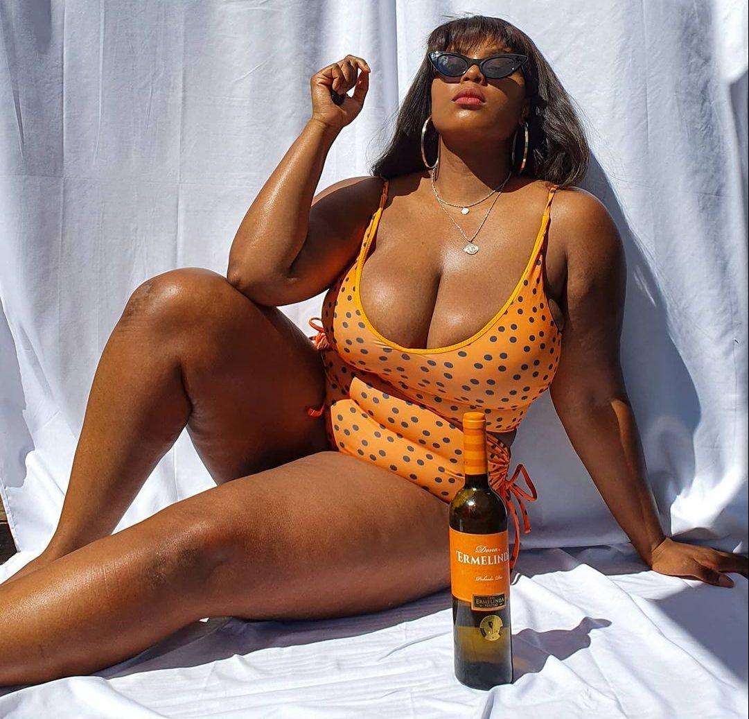 Woman wears orange polka dot swimsuit