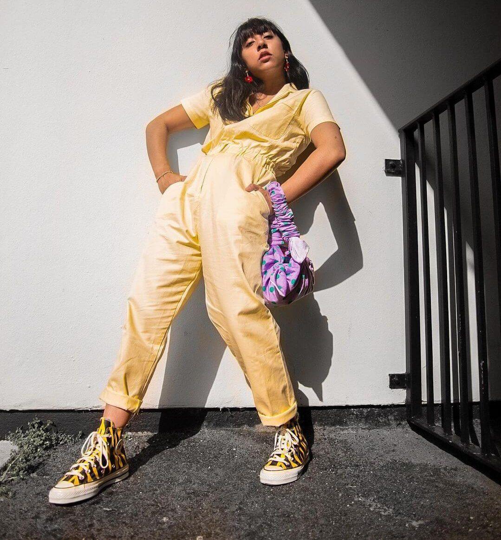 izzy manuel wearing sunshine yellow jumpsuit